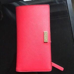 Bright pink Kate spade wallet